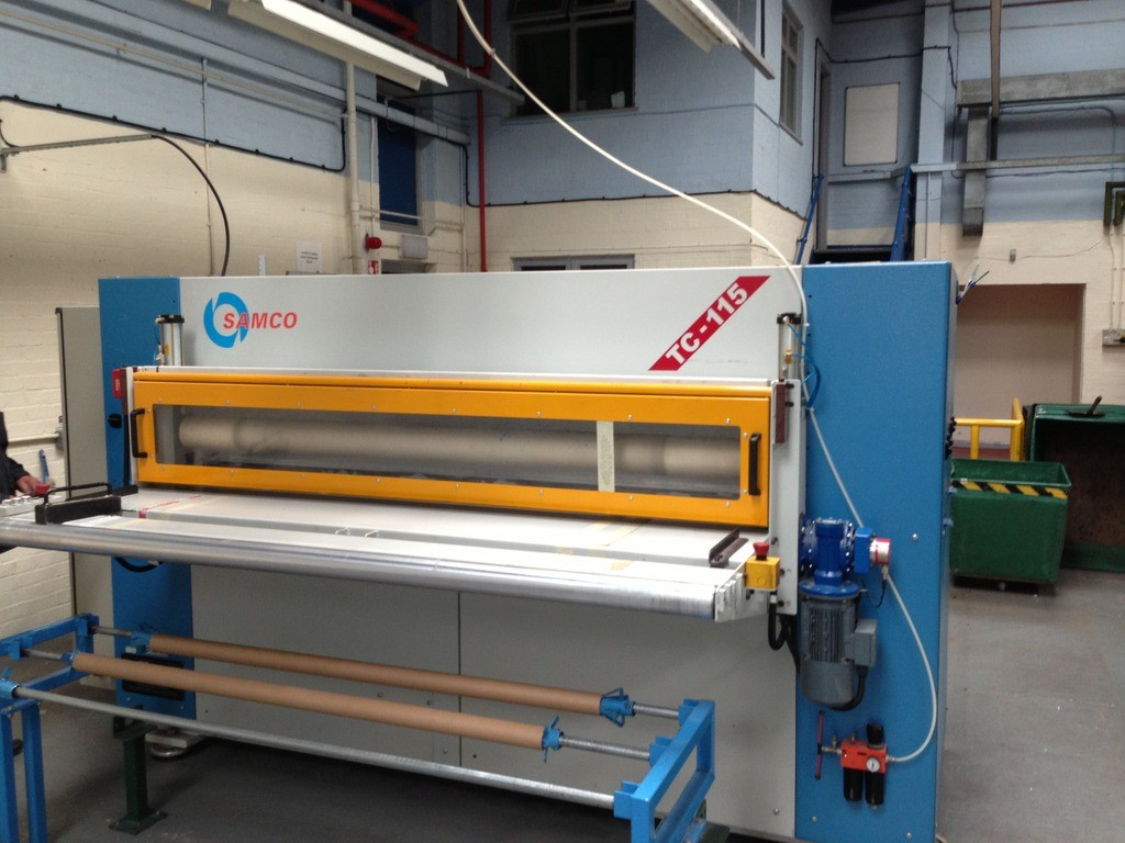 SAMCO TC115 full beam press with back feed roller system